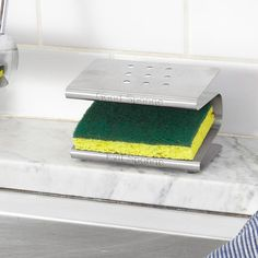 This stainless steel Spongester rack helps expunge bacteria while keeping it clean with two distinct shelves for your separate sponges.