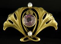 Art Nouveau Ginkgo  A beautiful Art Nouveau brooch of intertwined ginkgo leaves surrounding a lavender pastel Amethyst.  Created by Whiteside & Blank in 14kt gold, circa 1900.