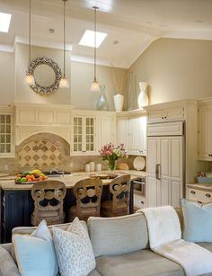 Dreamy kitchen and living room  I like the backsplash, the ceiling & skylights; cute barstools!