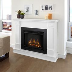 @Overstock - This beautiful electric fireplace by Real Flame has handsome pillars with a classic design that creates an understated elegance in any room. The electric firebox emits up to 4600 BTUs per hour and has dual heat settings of 675w and 1350w.http://www.overstock.com/Home-Garden/G8600E-W-Silverton-Electric-Fireplace-by-Real-Flame/6805730/product.html?CID=214117 $514.99