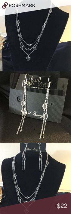 "Park Lane jewelry close outs ParkLane 2 pic set necklace and matching earrings, 3 tier silver tone chain with clear crystal insets of ovals, diamond shape and a heart in center. Chain is 16 "" with a 3"" extender? Earrings have a 3"" drop French wires. Necklace clasp is lobster claw Park Lane Jewelry Necklaces"