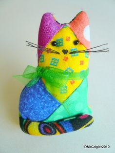 Oooh, a scrappy cat pin!  In bright colors!
