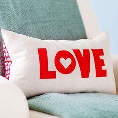 """Love"" stenciled on canvas pillow"