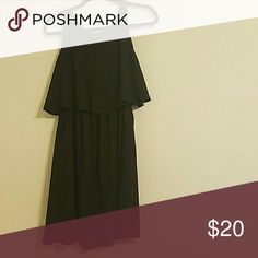Easy, breezy black dress Cute, flowy silhouette. Elastic at waist with loose over layer. 100% polyester. Soprano Dresses