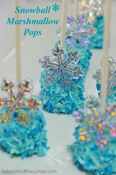 Snowball Marshmallow Pops are wonderful pillows of marshmallow encased in melted vanilla candy and dipped in sweet coconut. The perfect one bite dessert.