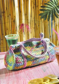 crochet purse pattern - Inspiration! - elongate the pattern and use it to carry around your Yoga or Pilates mats!!! - will have to change the strap for the too - and have it rap around and button instead o pinched like that and buttoned on the top like it is in the pic.