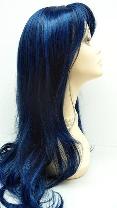 With a long 26 inch length and a dark midnight blue color, this wig is definitely a surefire attention getter. This wig is made with premium