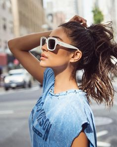 Shay Mitchell casual outfit, graphic tee, white sunglasses and ponytail