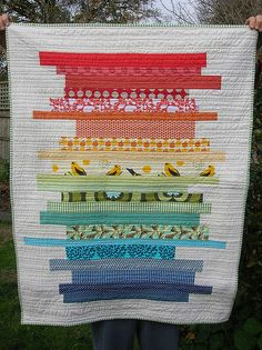 Love love this stacked scrap quilt. Traditional quilt patterns don't appeal so much to my contemporary taste, and this would be a great way for me to use up a ton of my scraps.