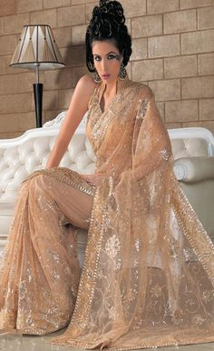 Fawn Net #Saree with #Blouse @ $54.61 | Shop @ http://www.utsavfashion.com/store/sarees-large.aspx?icode=slsyc399