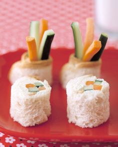 Kids will be happy to eat these veggies parading as sushi. Flatten 2 slices of bread with a rolling pin. Mix together 3 tablespoons cream cheese and 1 1/2 tablespoons sour cream; spread over slices. Lay two carrot and two cucumber matchsticks (6 inches long) at the bottom of each slice -- let hang over edges. Roll up bread, pressing gently to seal, then cut each roll in four equal pieces.