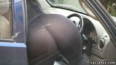 Sexy big butt in see through transparent lycra leggings tights outside bending over into car. Big bottoms big bum ass big arse asses butts booty.