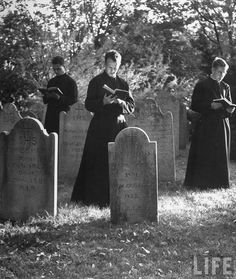 Seminarians praying the Breviary in a cemetery, probably during November (month of the Holy Souls).