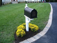 mailbox w/flowers. I like this way because I wouldn't be scared the mailman would run over them. #MailboxLandscape #MailboxLandscaping
