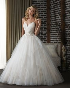Bonny Bridal lace gown with straps. I like the shape of the top. Not so into everything from the sparkly starfish thing down.