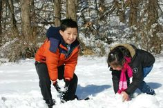 Kids playing in the snow GLoucacelunaphotography