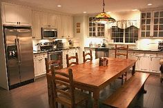 Modern gourmet kitchen with all ammenities and large harvest table