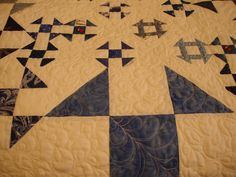 Quilting on Shoo-fly quilt.  Shoo Fly with Churn Dash blocks