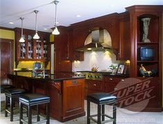 Cherry Cabinets with  black Granite Countertops and tile floor   Cherry cabinets, island with eating bar, stools. Countertops are black ...