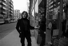 British singer and songwriter John Lennon (1940 - 1980) and his wife, Japanese-born musician and artist Yoko Ono, enter a shop in their neighborhood, around Bank Street in Greenwich village, New York, New York, October 1972.
