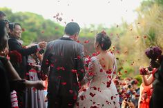 Guests showered the couple with red rose petals as they left for the reception. | www.BridalBook.ph
