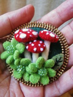 I have a large collection of hand made mushrooms... I use them in my pincushions and little terrariums... I thought I'd try to use them in a woodland brooch today...