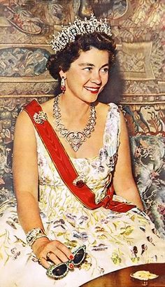 The diamond and pearl necklace, seen here worn by Queen Frederica in 1958, was later worn by her second daughter, Princess Irene as a tiara