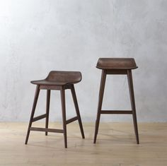 "<span class=""copyHeader"">elegant lines.</span> Stunning in it's simplicity, this ultra sophisticated stool is surprisingly comfy, too. Low back, slim seat cuts a striking silhouette in natural shesham wood, known for its rich color and active grain. Long rounded legs elegantly taper from top to bottom, intersecting a support slat designed so feet can rest easy. Hand-applied midtone stain ads warmth and brings out the wood's natural beauty. Polished and price-looking, this stool is the…"