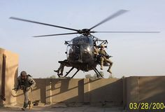 Rangers dismounting from an MH-6 Little Bird Helicopter. Looks just like my game :).