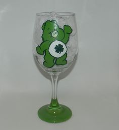 Good Luck Bear wine glass. Hand painted 20 ounce wine glass with Good Luck Bear from the Care Bears on it. The bottom of the base is painted green to match. Each one of my glasses is hand painted, no stickers or vinyl are used, and they are hand wash only. Because of the nature of each glass being hand painted, lines may vary from glass to glass, and color may vary from different screen resolutions. Please don't hesitate to contact me with any questions you may have!.