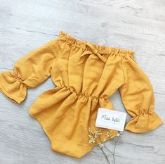 This sweet and simple bubble playsuit is made of leight weight prewashed linen fabric. Features off the shoulder style, full length ruffle sleeves. Perfectly shaped waist with stretchy elastic. Snaps at the crutch for easy nappy changes.