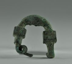 Phrygian bronze fibula, 6th century B.C. 2.5 cm long. Private collection
