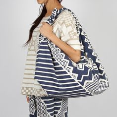 Vibration Knot Tote Bag from P.A.M -   Features hand screen printed unique aztec design on the outer. Inside contains plain white liner and oversize handy pocket (1 only) $218