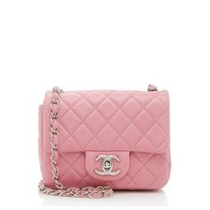 This iconic Chanel bag is made from quilted pink lambskin with silver-tone hardware. The mini design features a signature CC turnlock, back pocket, and woven chain shoulder strap. The interior is lined in pink leather with one open pocket and one zippered pocket.