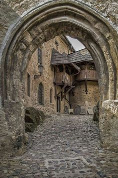 Cobbled Path through a Medieval Archway at Loket Castle, Czech Republic ~ photo via furkl . Medieval Village, Chateau Medieval, Medieval Castle Layout, Beautiful Castles, Beautiful Buildings, Beautiful Places, Modern Buildings, 12th Century, Abandoned Places