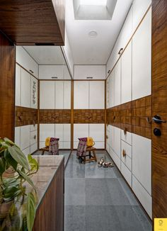 Duplex Penthouse Lends A Certain Earthiness To Space | Vishwa Design Studio - The Architects Diary Wardrobe Door Designs, Wardrobe Doors, Interior And Exterior, Interior Design, Dream Closets, Exposed Brick, Architectural Elements, Architects, New Homes