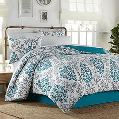 Carina 8-Piece Full Comforter Set in Turquoise - absolutely LOVE this print, and the colors. Redo of my room one day!