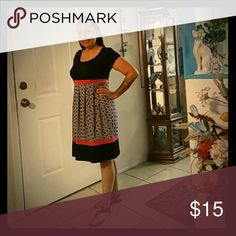 Enfocus Studio Dress Modeled by Cynthia Black and dark Pink with really pretty print Sleeveless knee length is great for a lot of occassions. Enfocus Dresses Midi