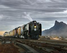 "John Willemsen   Union Pacific 844 4-8-4 ""Northern"" type steam locomotive built by the American Locomotive Company in December of 1944 for the Union Pacific Railroad. Shown here passing Picacho Peak, Pinal County, Arizona on its Arizona Centennial Journey, just before its retirement.    NIKON D7000 Nikon 16-85mm 85mm/ƒ/8/1/400s/ISO 200  Follow us on our facebook page: www.facebook.com/groups/desertmagazine   every issue of desert magazine can be read on www.swdeserts.com   #desert #swdeserts…"