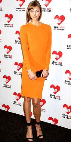 Karlie Kloss in #orange Michael Kors dress and black accessories