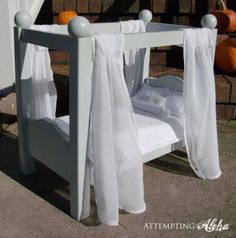 I used the base of Ana's Farmhouse doll bed as a jumping-off point for my canopy doll bed. A free PDF pattern of the headboard/footboard is available on my blog here:  http://attemptingaloha.blogspot.com/2011/11/diy-canopy-doll-bed-its-done...