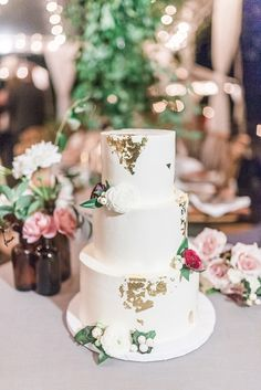 Metallic gold printed wedding cake: http://www.stylemepretty.com/virginia-weddings/2017/02/16/this-ceremony-spot-will-stop-your-heart-its-that-good/ Photography: Julie Paisley - http://juliepaisley.com/
