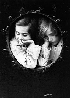 Two young German-Jewish refugees at the porthole of the liner 'St. Louis' finally arrive at Antwerp, after being refused entry to Cuba and Miami prior to the start of WW II, 1939 (Gerry Cranham)