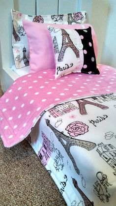 """5+piece+Paris+doll+bedding+made+to+fit+18""""+doll+beds.++Features+a+cotton+Paris+print+fabric+backed+by+a+pink+and+white+polka+dot+light+flannel+print+fabric. Set+includes+the+following: Comforter+(17""""x21"""") Flanged+Pillow Pillow+Case Pillow+Form Small+Accent+Pillow **Bed+and+Mattress+are..."""