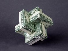 Hello,    Up for sale is a beautifully crafted Umulius Rectangulum. Its made with 3 brand new dollar bills.    It makes a great novelty gift