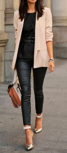 Black leather pant with cream brown coat . HMMMMM matching   Gloss Fashionista