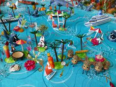 Sara Drake - South Pacific detail from large 3D world map. Maps are made from mixed media, including papier mache, balsa wood, acrylic paint, beads and wire. All details are hand made and to commission. Each map is personalised with the details of the client's own travels.