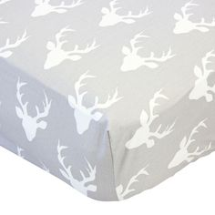 This crib sheet features a fun and boyish deer head pattern on a gray background. Mix and match this crib sheet with your favorite crib skirt to create the perfect baby bedding for your nursery. This