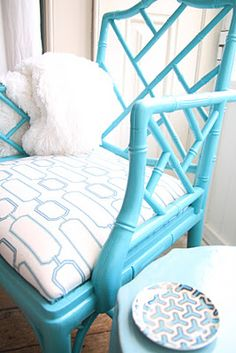 Love the use of robins egg blue in this chair. Perfect for a vacation home. Adds a great pop of color!