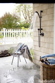 In a Southern California bachelor pad designed by Parrish Chilcoat and Joe Lucas, an outdoor shower is mounted above a patio facing the beach.   - HouseBeautiful.com